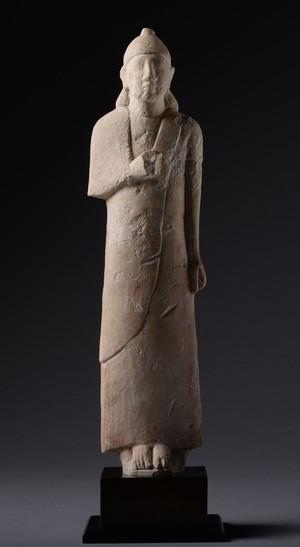 Limestone votive figure