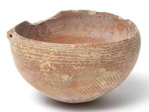 Red bowl with incised decorations