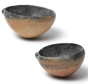 2 black topped bowls