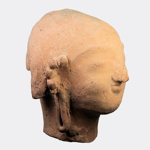 Half size terracotta head from votive figure