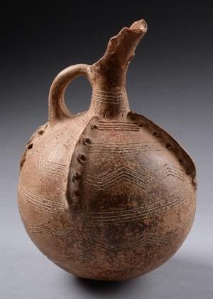jug with pierced ribs