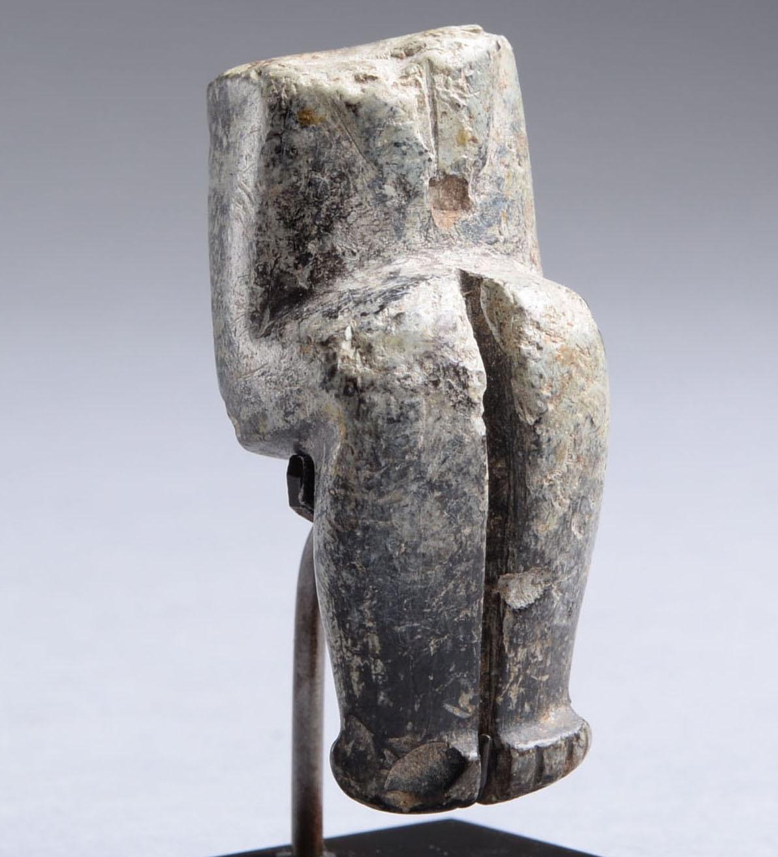 picrolite cruciform-figure fragment.